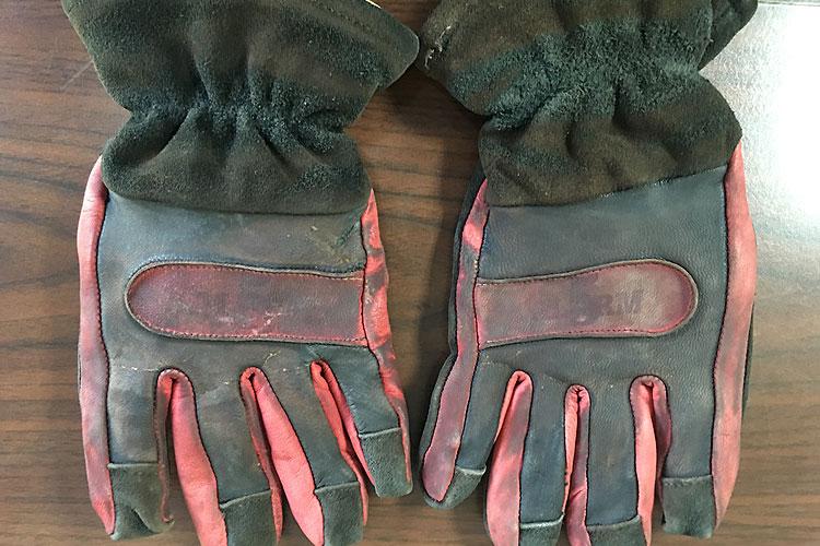 The burned gloves.