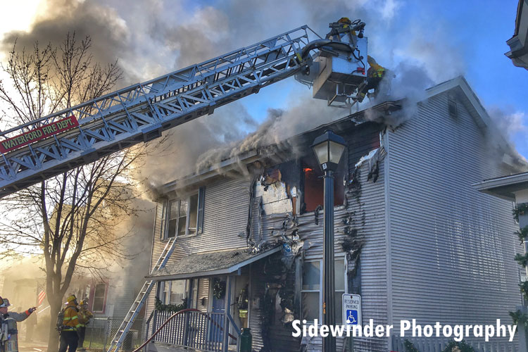 Tower Ladder in operation at a fire in a multi-dwelling in Waterford, New York.