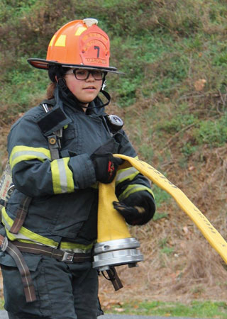 (1) A junior firefighter from the New Egypt (NJ) Volunteer Fire Company pulls hose. <i>(Photos by Paige Kahler, Five Points Photography.)