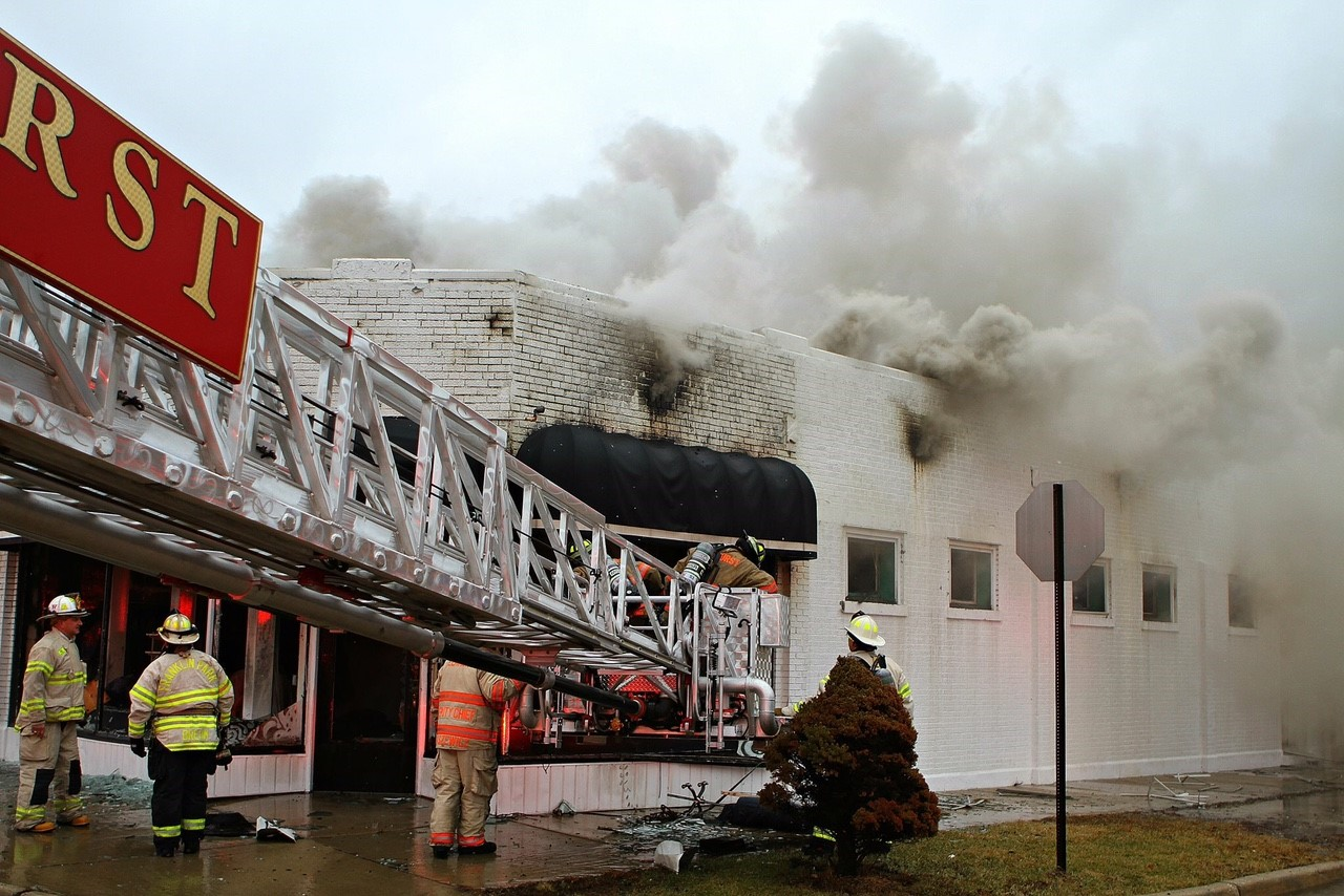 Firefighters work at the scene of a fire in a bridal shop in Elmhurst, Illinois.
