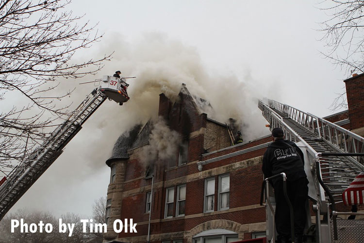 Chicago firefighters on scene of a structure fire in an older building.