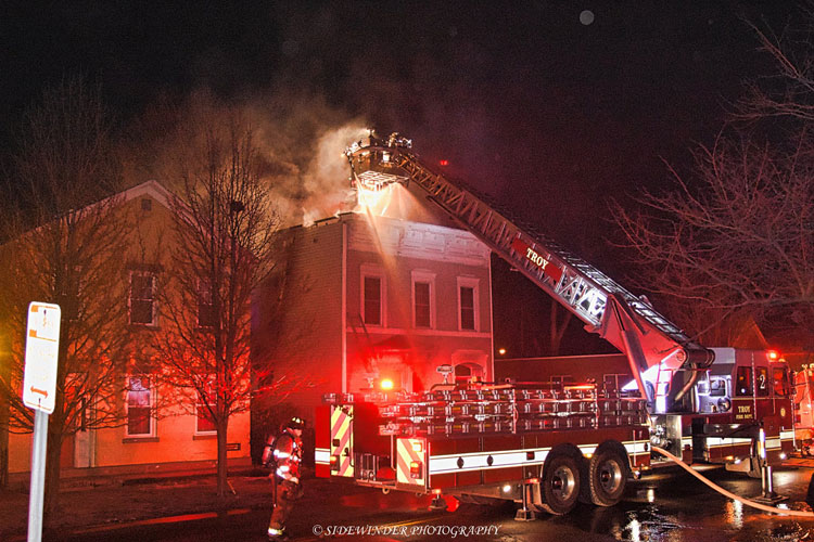 Troy Fire Department aerial device at the scene of a residential fire.