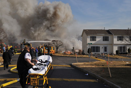(2) The house exploded. This stretcher was to be Knapp's ride to the trauma/burn center. Note the gas company trucks just beyond the stretcher.