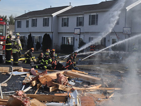 (3) Note the size and the mass of the house framing blown across the street from this single-home explosion.