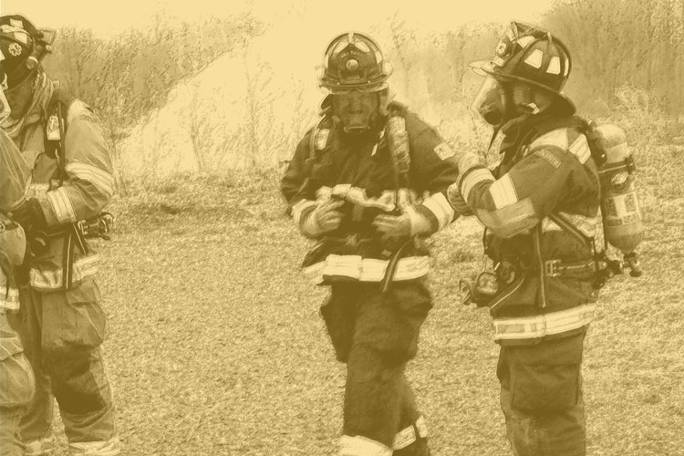 Firefighters in full SCBA and turnout gear