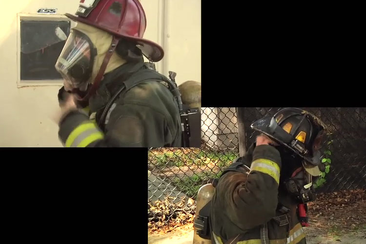 Firefighters mask up prior to making entry at a structure fire.