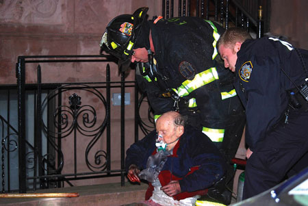 (4) The victim is assisted by a member and attended to by emergency medical services. The injuries to the victim's hands indicate the conditions in his apartment and resulted in his being unable to assist in his rescue. The victim put on the hooded jacket to protect himself.