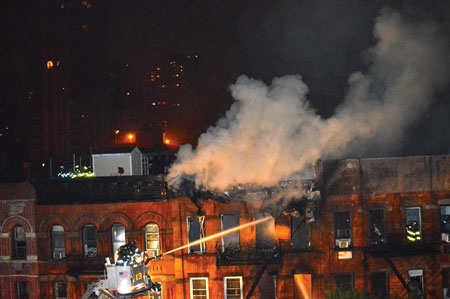 (5) A tower ladder operated because of the extremely large volume of fire in this building.