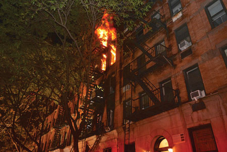 (7) The front fire escape and the lack of a rear fire escape necessitated a rescue from the fifth floor using a lifesaving rope.