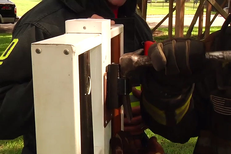 Firefighters perform forcible entry