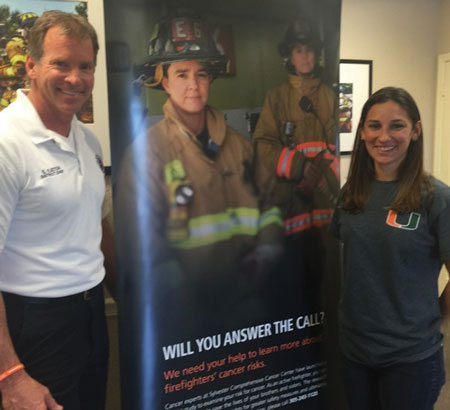 (7) PBC Firefighter Health Dr. Natasha Schaefer Solle, Sylvester Comprehensive Cancer Center, and Samuel A. Eaton, PBCFR battalion chief, when the new displays were delivered. (Photo courtesy of Tara Cardoso, public relations specialist, FFSHC FACE.)