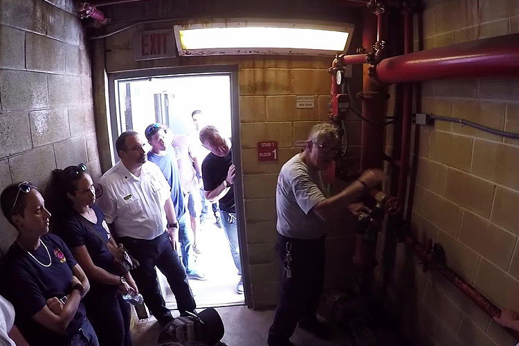 Bill Gustin and other firefighters train on building standpipe systems