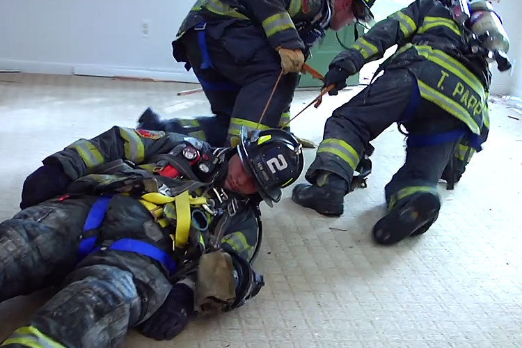 Removing a down firefighter