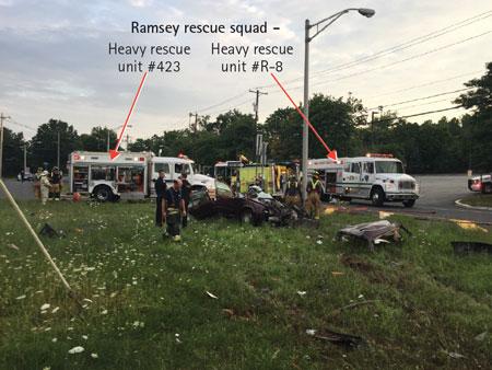 (1) Ramsey Rescue Squad-Heavy Rescue Unit #423 (arrow) and Heavy Rescue Unit #R-8 (arrow) conducted the extrication operations. <i>(Photos by author.)</i>