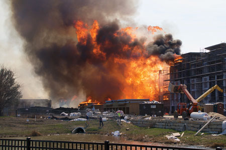 (1) Within minutes, a spark from a welder ravaged the apartment building under construction.<i> [Photos 1-2 by Jason Rhodes, Overland Park (KS) Fire Department.]</i>