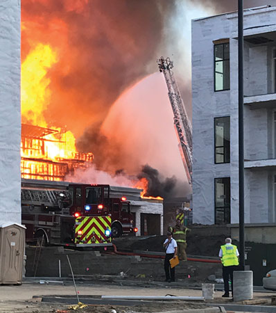 (3) Apparatus were positioned in place to protect exposure buildings in various stages of construction. <i>(Photo by Addie Chapin.) </i>