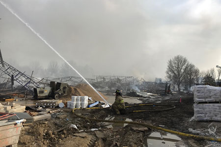(6) Crews continued to flow water well into the next day to ensure that the fires had been fully extinguished. (Photo by Addie Chapin.)