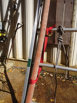 (4) A 36-inch-long loop of one-inch tubular webbing serves as a hose strap.