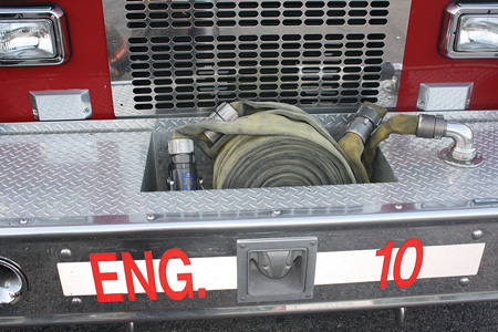 (1) View of the line packed in the hose well of the front bumper. <i>(Photos by author.) </i>