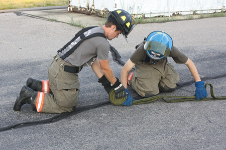"""(3) The firefighter is beginning the """"donut"""" roll."""
