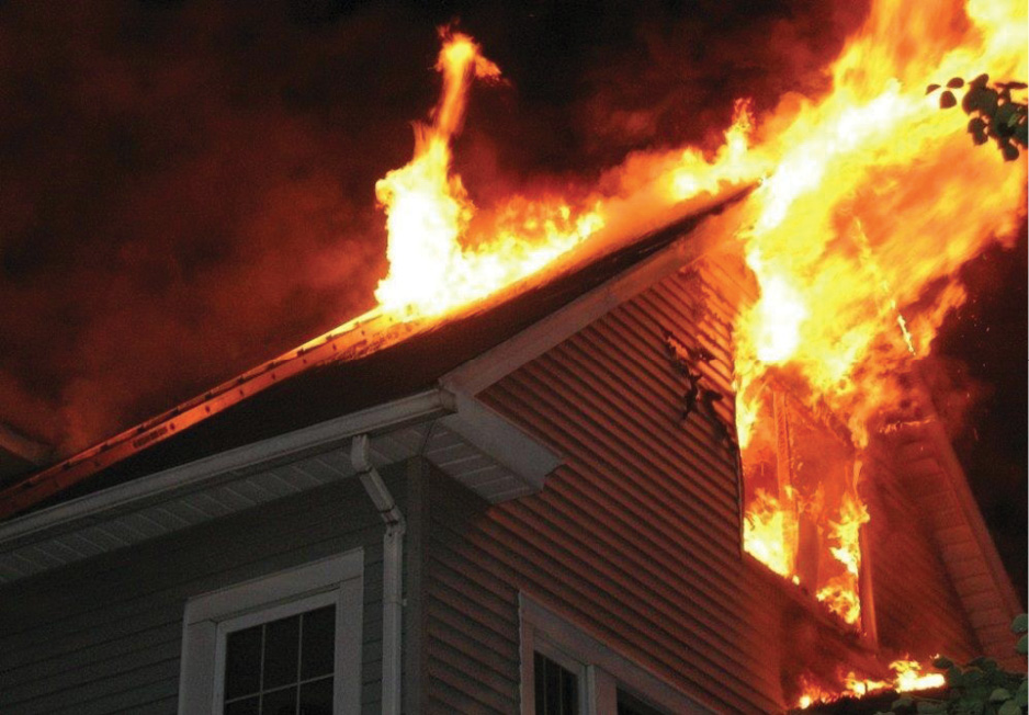 (1) This fire in a half-story shows the need for a coordinated aggressive fire attack. (Photo by Christine Ricci.)