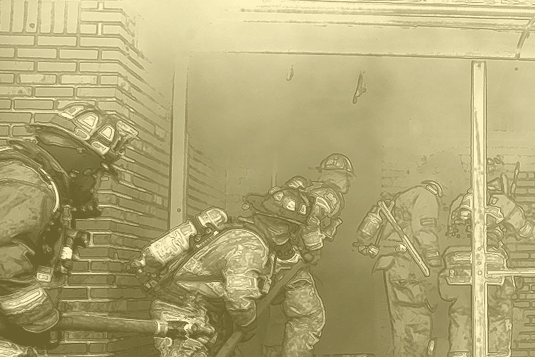 Firefighters advance a line into a dwelling during fire training