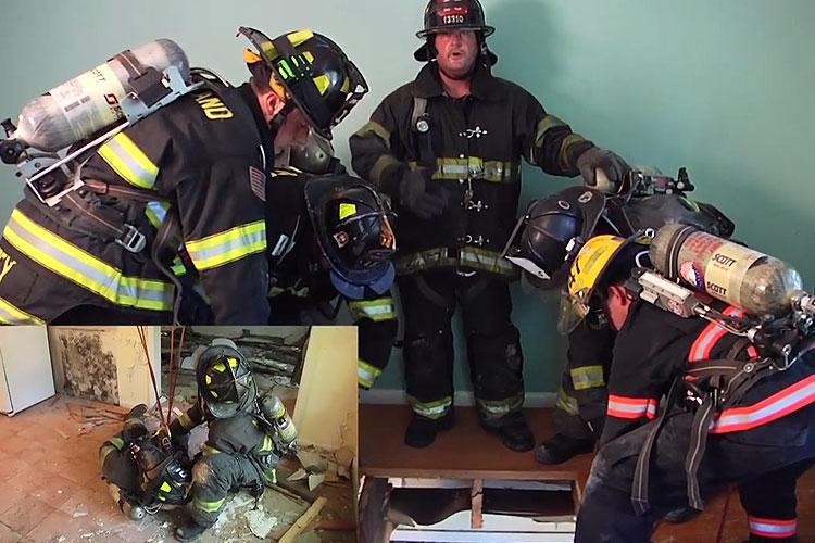 Firefighters rescue a colleague who has fallen through the floor