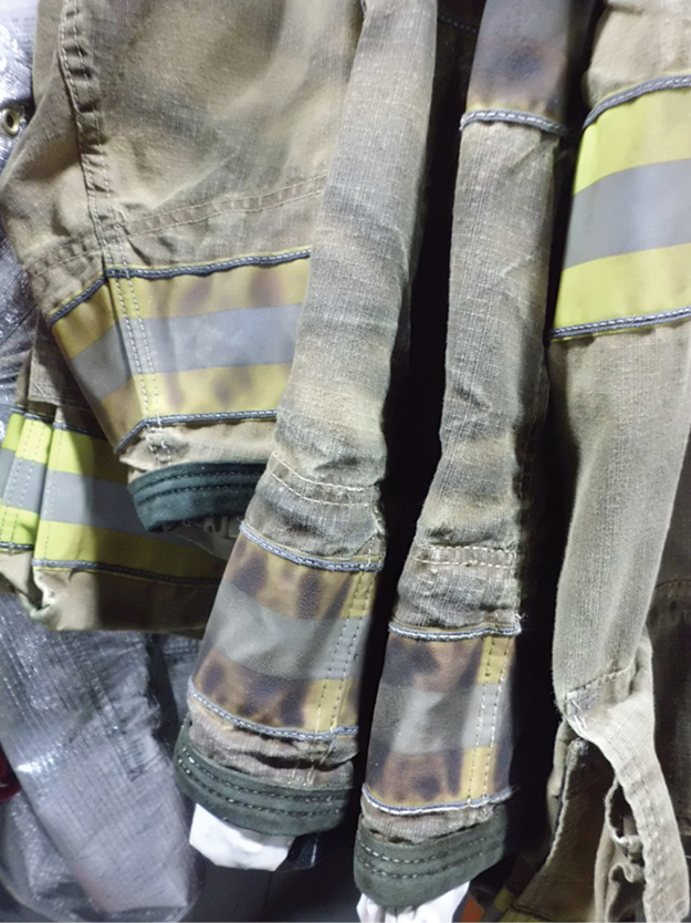 (2) Firefighter clothing becomes easily contaminated and retains that contamination if not properly washed; if soiling is visible, it is likely that the gear is still contaminated. (Photo courtesy of Gear Cleaning Solutions.)
