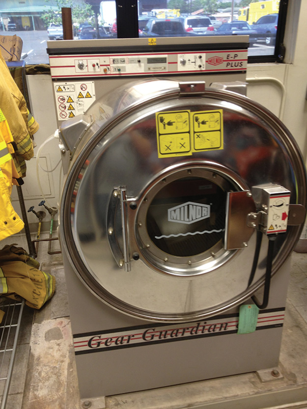 (3) The selection of the appropriate washer/extractor, detergent, and wash cycle are all important for the effective cleaning of turnout clothing. (Photo courtesy of Gear Cleaning Solutions.)