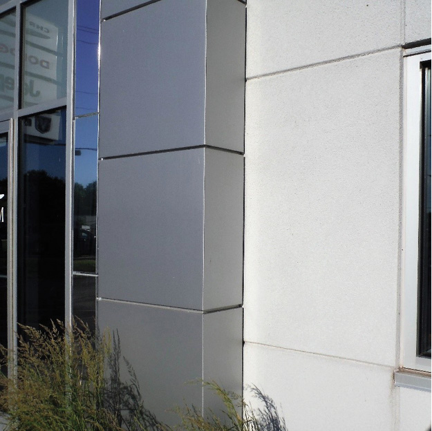 (1) An aluminum composite panel may be formed into any shape vertically and gives a modern look to new buildings or revitalizes older structures. This close-up image shows the shiny panel installed at the entrance of an auto dealership. (Photo by Greg Havel.)
