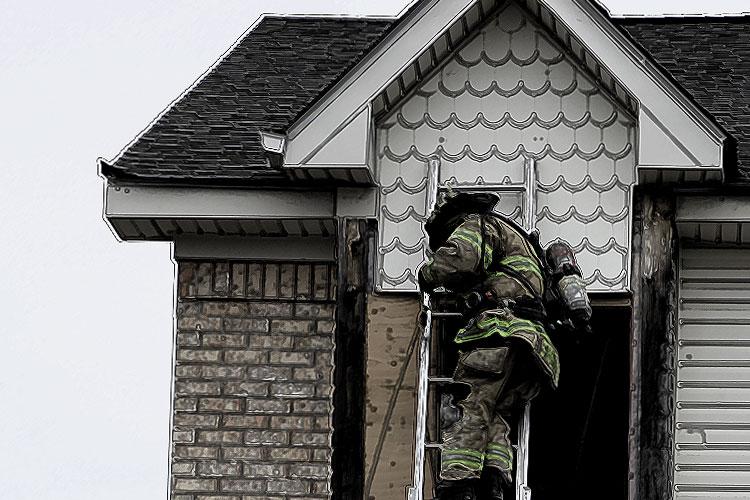 A firefighter on a ladder