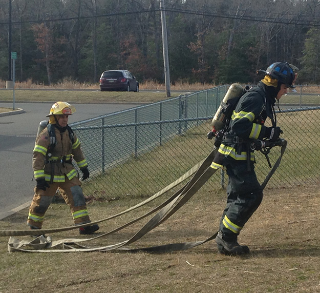 (3) When the line being dragged is longer than the firefighter is tall, it will snag on everything in its way. This is an extremely inefficient way to stretch a line.