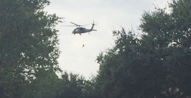 (4) USAF PJs deploy a rescuer down a line to a victim in Port Arthur.