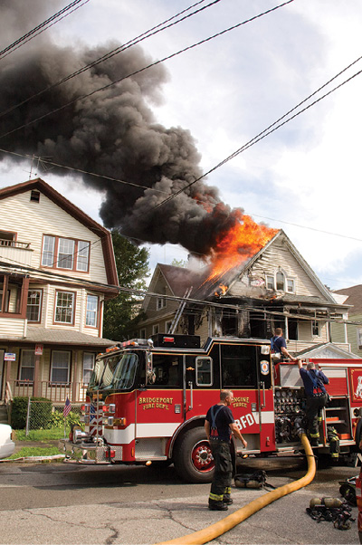 (12) Two Bridgeport, Connecticut, firefighters died as a result of this attic fire. (Photo by Keith Muratori.)