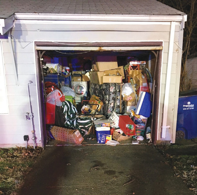 (1) Garages are commonly used for impromptu storage units and can contain heavy fire loads. This not only makes the fire content heavy but also can make access extremely difficult. (Photo by author.)