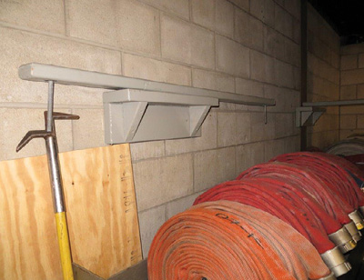 (12) The carpenters made shelves to store the braces when they are not in use so they don't get misplaced.