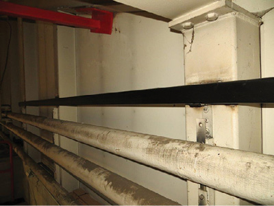 """(15) The black steel bar was welded to the rear wall of the platform that is used for """"tying off"""" exercises. o same."""