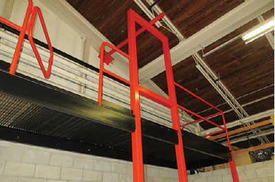(5) Note that the overhanging belay bar is welded to the frame of the building as well as the top of the window frame, adding much stability.