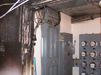 (1) A bus duct, a sheet metal enclosure for copper bus bars, is commonly used instead of cables in conduit for electrical distribution systems of high-rise buildings. This bus duct supplies power from main electrical panels on the ground floor to an electric meter room on an upper floor. [Photo courtesy of the Miami-Dade (FL) Fire/Rescue Department. Remaining photos by Eric Goodman unless otherwise noted.]