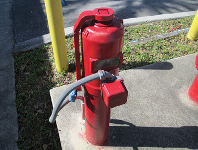 (2) A PIV controls the flow of water from a city water main to a building's fire suppression system. Closing this PIV will shut off the flow of water necessary to cool the building's fire pumps and the engine if it is powered by diesel, causing them to self-destruct.
