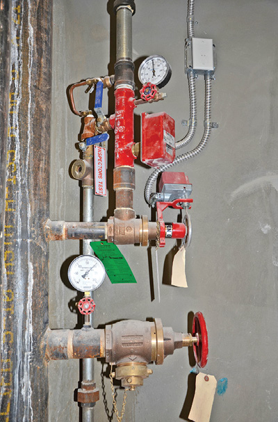 (3) To properly shut off the flow to the sprinklers supplied by a combination sprinkler/standpipe system, close the floor isolation valve above the hose outlet, and operate the test/drain valves (blue handles) to divert water remaining in the sprinkler piping to the one-inch drain riser.