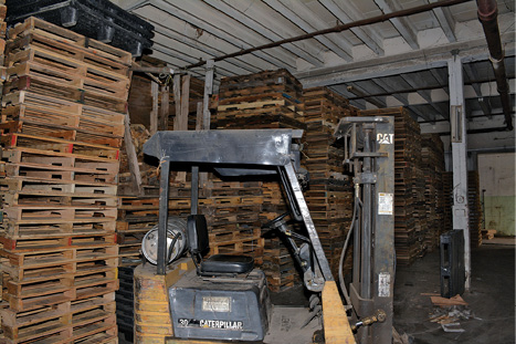 (5) The sprinkler system in this building was designed for a fire load of used clothing, but the occupancy changed to pallet storage. Unless the sprinkler system is upgraded to increase its flow, it is likely to be overwhelmed by a fire load for which it wasn't designed.
