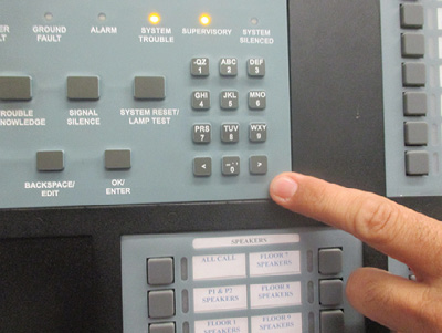 """(9) Lights on a fire alarm control panel indicate both """"trouble"""" and """"supervisory"""" alarms. The trouble alarm indicates a problem with the system's electrical circuits, and the supervisory alarm was initiated by a tamper switch when closing a valve in the suppression system. (Photo by Blas Bravo.)"""
