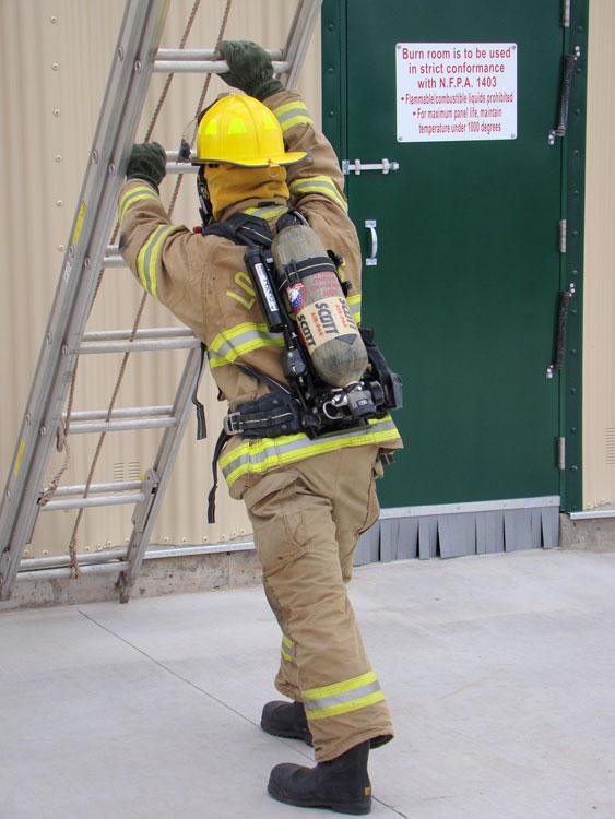 Firefighter raising a ladder