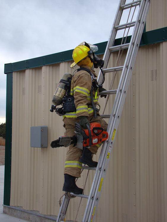 Firefighter performing ventilation