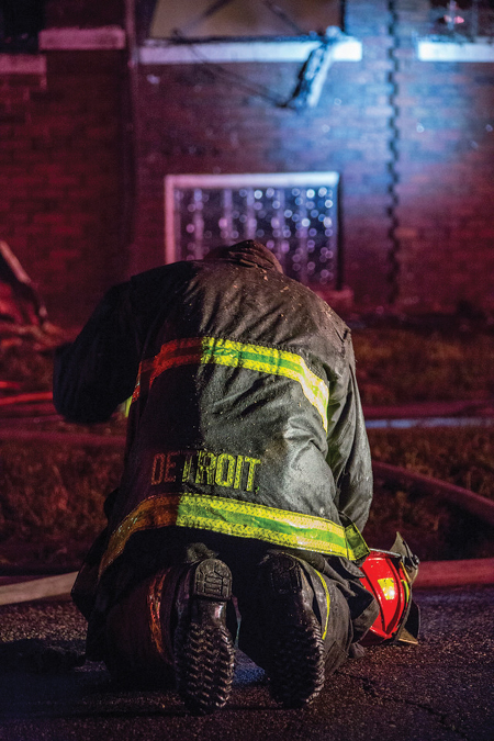 (5) At a 3 a.m. residential fire with people reported trapped, an aggressive fire attack, and searches, a firefighter falls to his knees in exhaustion in the street. So the community can fully understand it, we must show the weight on our firefighters' shoulders.