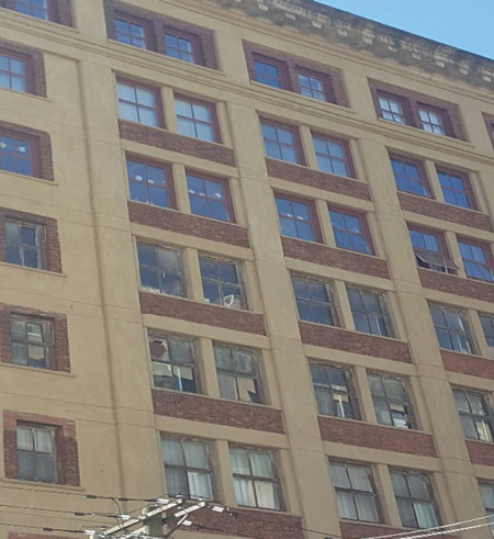 """(1) Even before firefighters enter this building, the windows are """"talking"""" to them. The top three floors may indicate a change of more than a window upgrade, while the old window frames below indicate what? Until a fire company performs a building recon to gather intelligence, fireground safety remains in jeopardy. (Photo by author.)"""