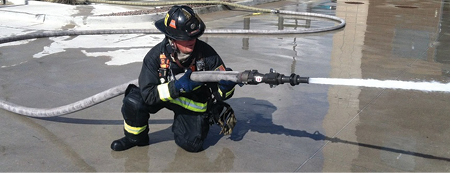 (2)By positioning his elbow against his raised leg, the firefighter increases his ability to resist the nozzle reaction forces.