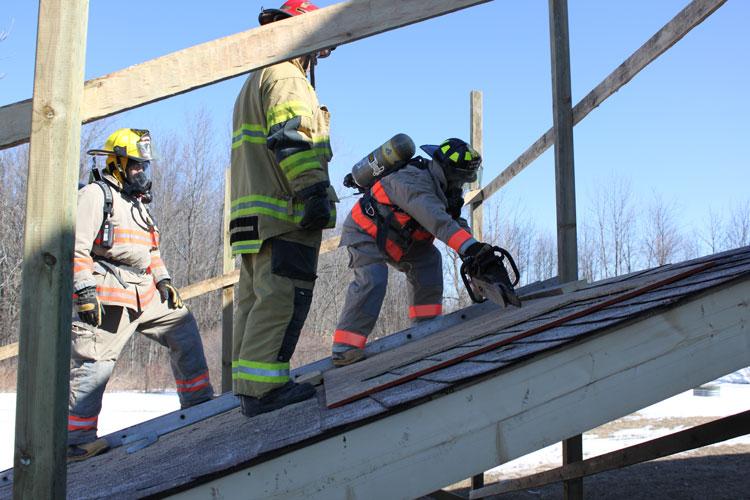 Firefighters perform vertical ventilation