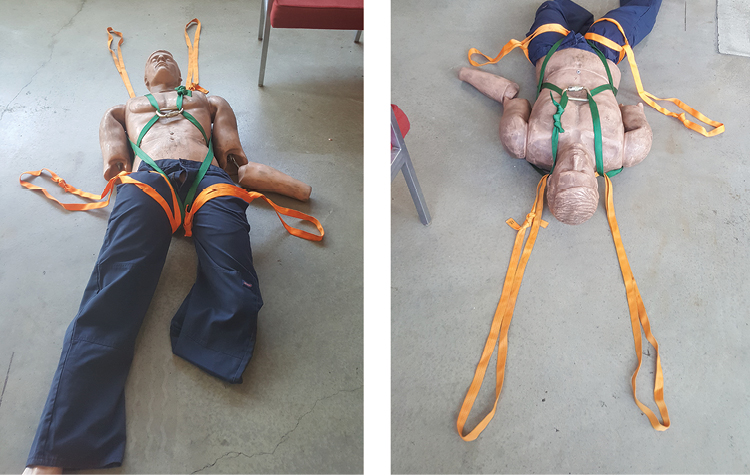 (2) The finished package with two additional grab loops added on the upper thighs using webbing loops and girth hitches. Four firefighters will be able to move a very large victim even if the victim has no clothing.